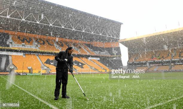 Snow falls before kick off at Molineux the home stadium of Wolverhampton Wanderers during the Sky Bet Championship match between Wolverhampton and...