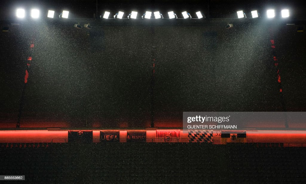 Snow falls during a press conference of Paris Saint-Germain ahead of the UEFA Champions League Group B match between FC Bayern Munich vs PSG Paris, at the Allianz Arena in Munich, southern Germany, on December 4, 2017. /