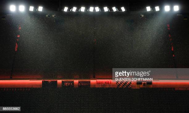Snow falls during a press conference of Paris SaintGermain ahead of the UEFA Champions League Group B match between FC Bayern Munich vs PSG Paris at...