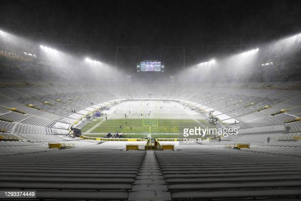 Snow falls during warmups between the Green Bay Packers and the Tennessee Titans at Lambeau Field on December 27, 2020 in Green Bay, Wisconsin.