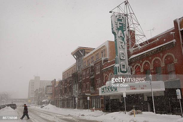 Snow falls in downtown March 30 2009 in Fargo North Dakota The city's heavy equipment was pulled away from the ongoing levee construction to deal...