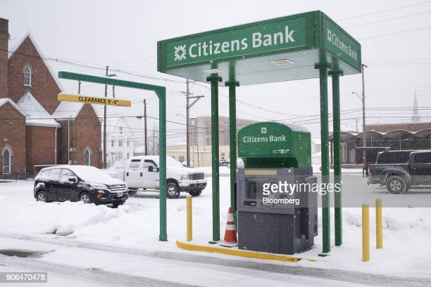 Snow falls in front of a drivethrough automatic teller machine outside a Citizens Financial Group Inc bank branch in downtown Portsmouth Ohio US on...