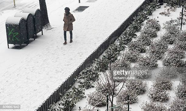 Snow falls in the Chelsea neighborhood of New York on Monday, February 15, 2016. A wintery mix of snow, rain and sleet has caused the New York Office...