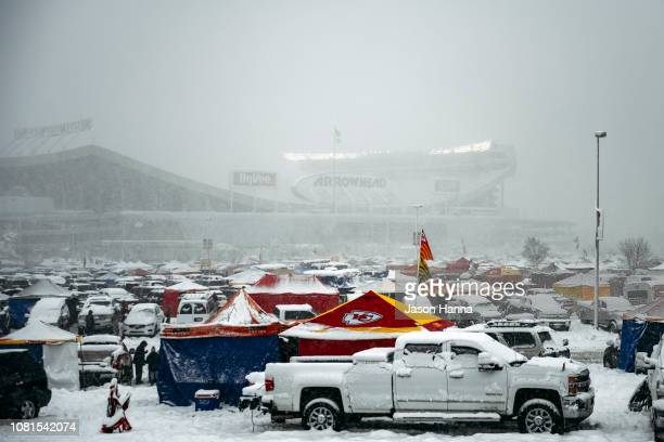 Snow falls leading up to the AFC Divisional Round playoff game between the Kansas City Chiefs and the Indianapolis Colts at Arrowhead Stadium on...