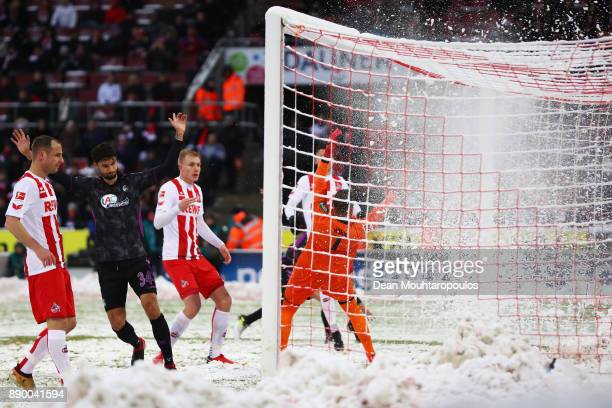 Snow falls of the goal net as Nils Petersen of SC Freiburg shoots and scores his side's first goal during the Bundesliga match between 1 FC Koeln and...