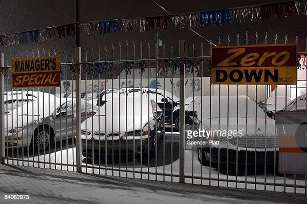 Snow falls on a used car lot on December 16 2008 in Detroit Michigan The city of Detroit one of America's poorest large urban cities is threatened to...