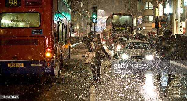 Snow falls on Oxford Street in central London as shoppers continue their lastminute Christmas shopping on December 21 2009 The death toll from winter...