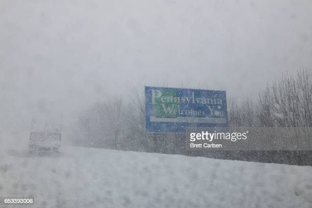 Snow falls on route 81 at the Pennsylvania/New York border after much of the northeast was covered from winter storm Stella on March 14 2017 in Great...