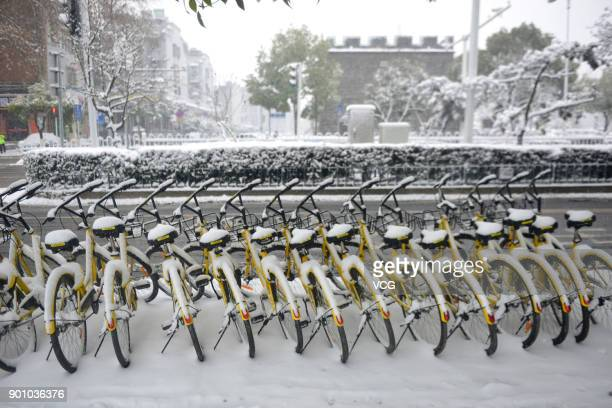 Snow falls on shared bikes on January 3 2018 in Xiangyang Hubei Province of China Rain and snow will sweep most of central and east China some...