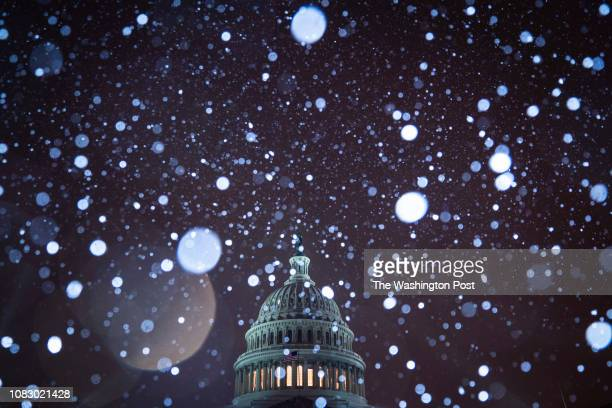 Snow falls on the 23rd day of the partial government shutdown the longest in US history at the Capitol Building on Sunday Jan 13 2019 in Washington DC