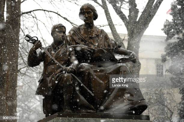 Snow falls on the Confederate Women's Monument at the State Capitol Grounds on January 17 2018 in Raleigh North Carolina Governor Roy Cooper declared...