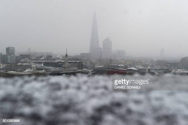 Snow falls on the Shard tower as temperatures plummet in central London on February 26 2018 Weather warnings were in place across Britain ahead of an...