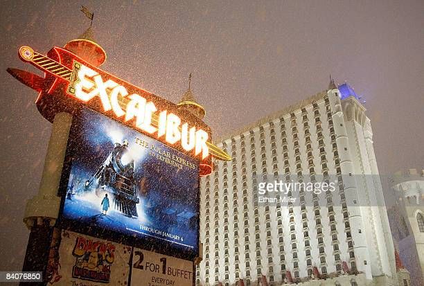 Snow falls outside the Excalibur Hotel Casino on the Las Vegas Strip during a rare snowstorm December 17 2008 in Las Vegas Nevada Several inches of...