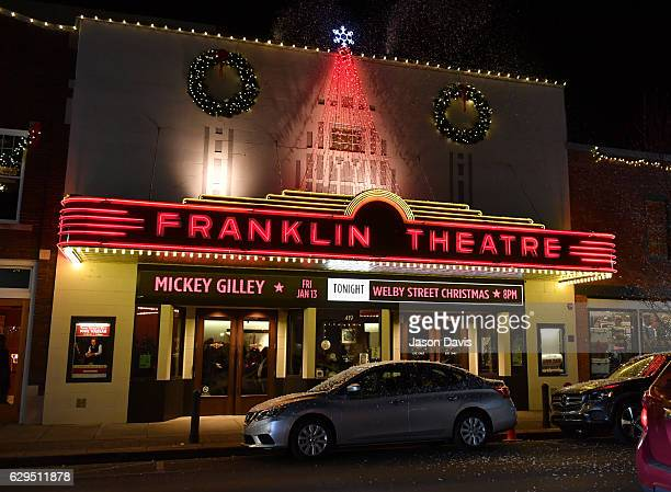 Snow falls outside Franklin Theater during A Welby Street Christmas Hosted by Serene Pearl at Franklin Theater on December 9 2016 in Franklin...