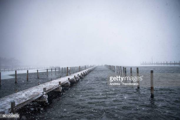 Snow falls over the Atlantic ocean at Bellport Marina as a blizzard hits the Northeastern part of the United States on January 4 2018 in Bellport New...