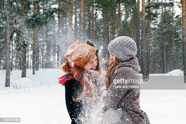 snow fight - teasing stock pictures, royalty-free photos & images