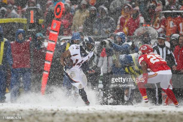 Snow flies as Denver Broncos wide receiver Courtland Sutton makes a cut during a 33yard reception in the third quarter of an AFC West game between...
