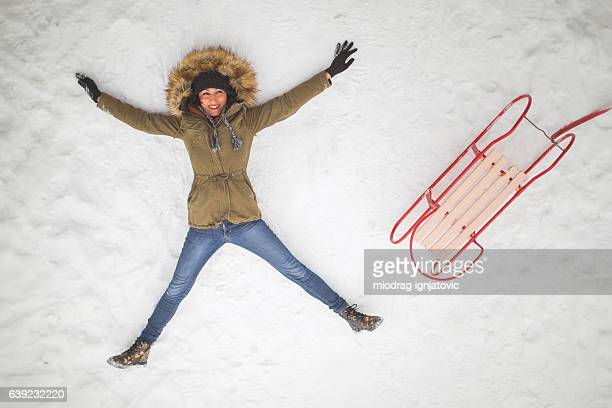 snow freedom - snow angel stock photos and pictures