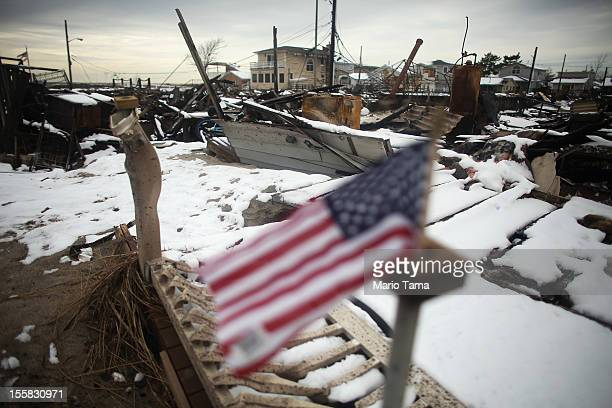 Snow from a Nor'Easter storm coats homes burned in the aftermath of Superstorm Sandy on November 8, 2012 in the Breezy Point neighborhood of the...