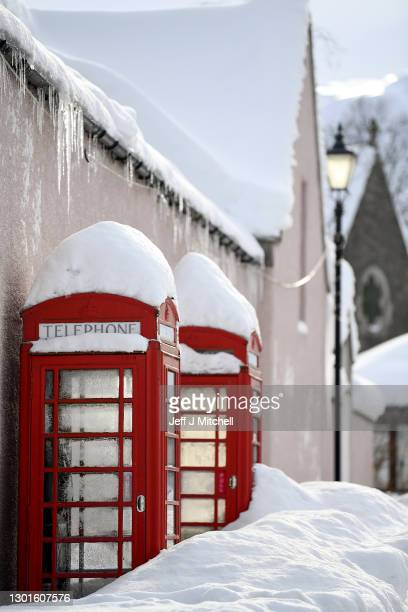 Snow gathers on the roof of a phone box on February 11, 2021 in Braemar, Scotland. A low of -22.9C was recorded overnight in the Scottish Highlands...