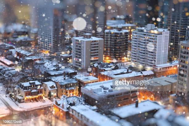 snow globe of miniature toy-ronto - christmas scenes stock pictures, royalty-free photos & images