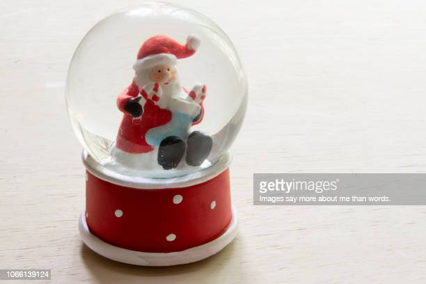 a snow globe with santa claus inside. - music box stock pictures, royalty-free photos & images