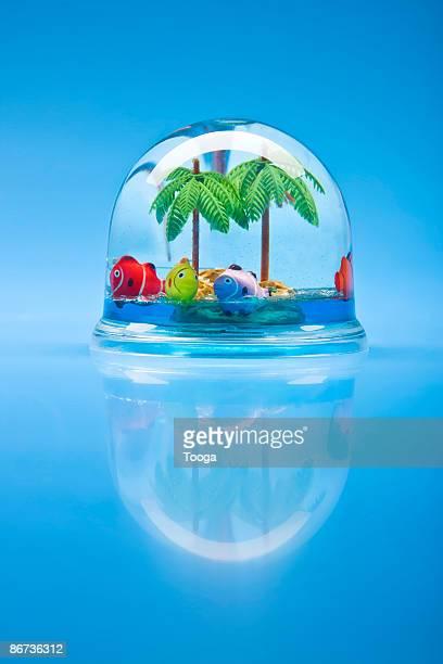 Snow globe with tropical scene