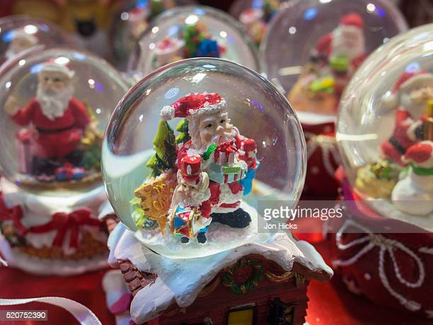 Snow globes for sale in the Pisa Christmas Market, Italy.