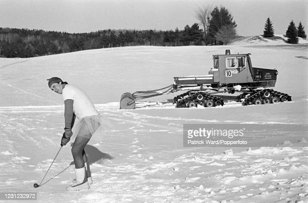 Snow golf competition in fancy dress near Bretton Woods, New Hampshire, USA, circa January 1981. From a series of documentary images produced during...