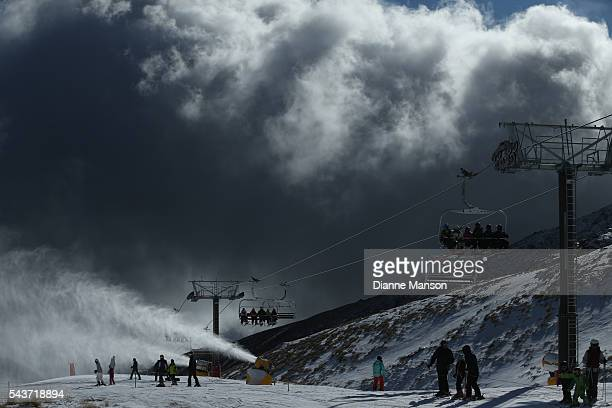 Snow guns in action due to warm weather reducing the snow levels during the DB Export Dog Derby at the Remarkables ski field on June 30 2016 in...