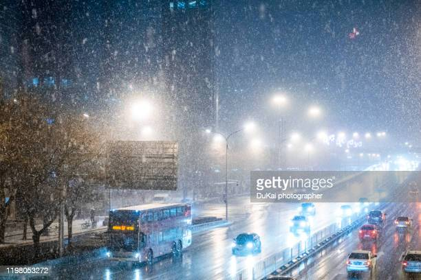snow in beijing business district - beijing stock pictures, royalty-free photos & images