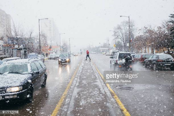 Snow in the city, heavy snowfall and city traffic