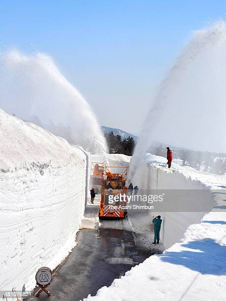 Snow is blown from the snow remover during the preparation work to open Hakkoda Towada Gold Line at Kasamatsu Pass on March 27 2014 in Aomori Japan...