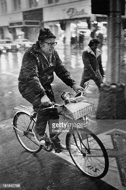 APR 1 1977 APR 2 1977 Snow Is No Joke This bicyclist finds himself out in the cold Friday evening as he pedals his cycle near 15th and California Sts...