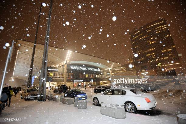 Snow is seen falling in the center of Warsaw Poland on December 20 2018 Poles this year will spend on average 6 percent more on Christmas shopping...