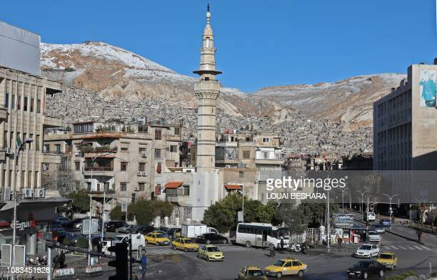 Snow is seen on Mount Qasion in the Syrian capital Damascus on January 17 2019 Freezing temperatures and the lack of medical care have killed at...