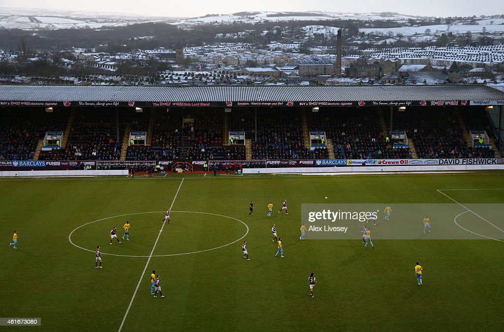 Snow is seen on the hills surrounding Turf Moor as Burnley take on Crystal Palace during the Barclays Premier League match between Burnley and Crystal Palace at Turf Moor on January 17, 2015 in Burnley, England.