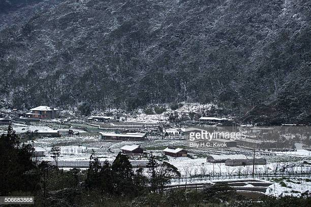 Snow is seen on the Yangmungshan National Park during a snowfall in Taiwan on January 25 2016 in Taipei Taiwan Local media reported at least 85...