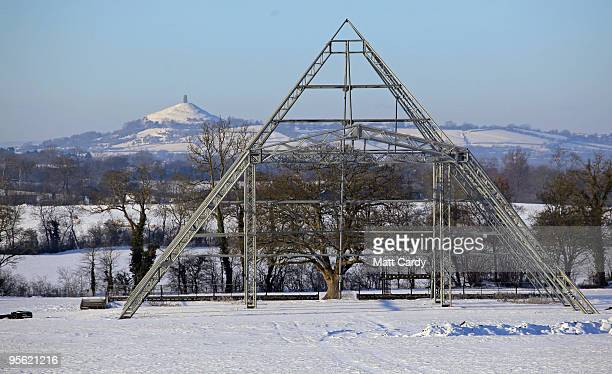 Snow lies on the ground around the skeleton of the main Pyramid stage at the Glastonbury Festival site at Worthy Farm Pilton on January 7 2010 in...
