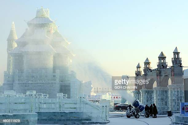 A snow making machine blows artificial snow over the China Ice and Snow World during last minute preparations for the opening ceremony of the 15th...