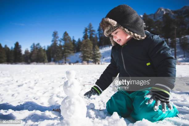 snow man fun - mt charleston stock photos and pictures