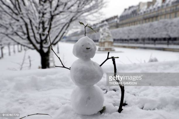 TOPSHOT A snow man is pictured in the Tuileries garden are pictured on February 7 2018 following heavy snowfall in Paris Exceptionally heavy snowfall...