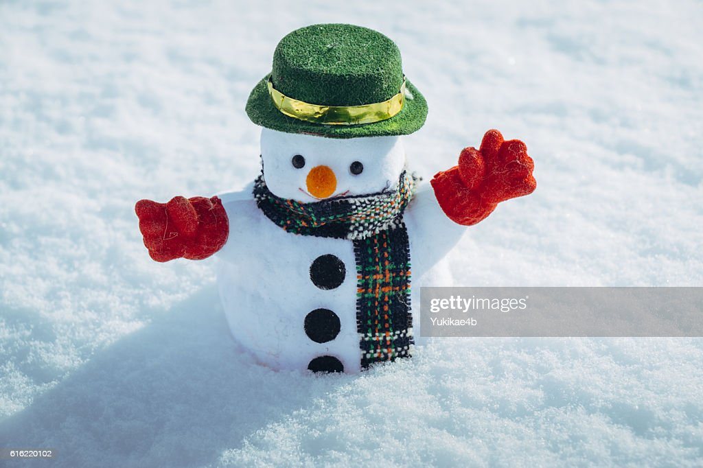 Snow man stand among pile of snow. : Stockfoto