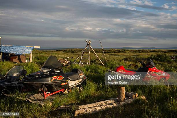 Snow mobiles lay in the grass on July 3 2015 in Newtok Alaska Newtok is one of several remote Alaskan villages that is being forced to relocate due...