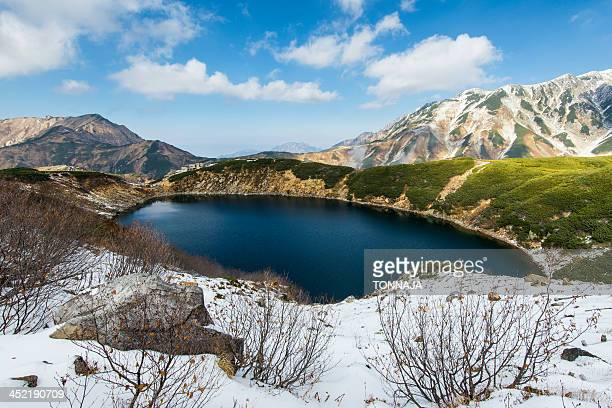 snow mountain and blue lake - 富山県 ストックフォトと画像