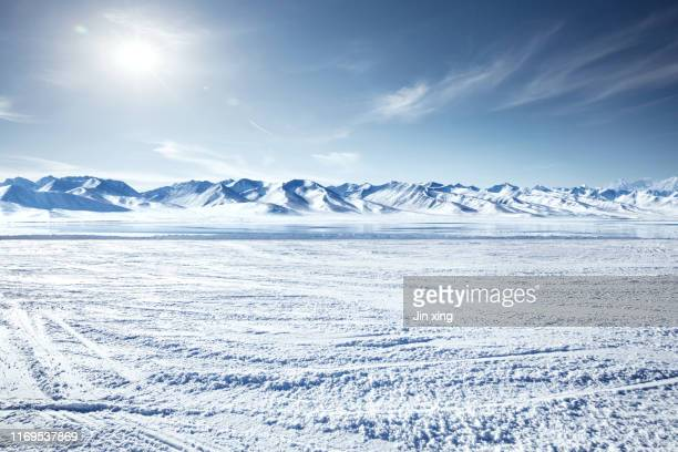 snow mountain and lake in winter - deep snow stock pictures, royalty-free photos & images