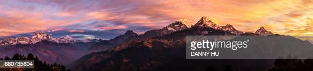 snow mountain annapurna base camp at sunrise, nepal - sunrise mountain peak stock pictures, royalty-free photos & images