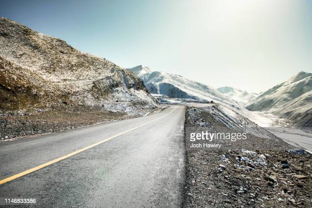 snow mountain road - mountain road stock pictures, royalty-free photos & images