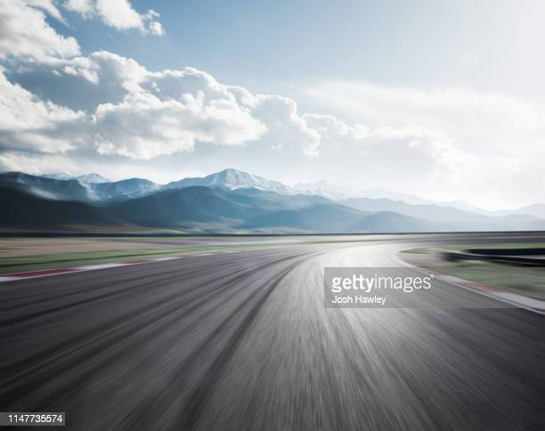 snow mountain road - motor racing track stock pictures, royalty-free photos & images