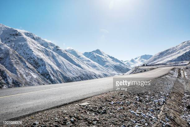 snow mountain road - deep snow stock pictures, royalty-free photos & images